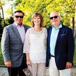 Board president John Mongelluzzo, board member Kelly Hitter and Chris Adams, Stepping Stones executive director