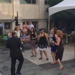 Guests at Taste of Duveneck dance in the Courtyard.