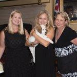 Melanoma Know More executive director Leanne Blair; Debbie Williams, winner of a puppy named Tweed; and board member Tami Burgoyne