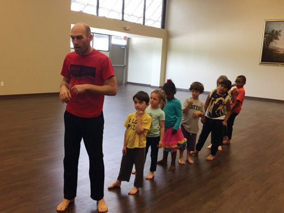 Joshua Brown, of Inland Dance Theatre, leads a movement class for young children.