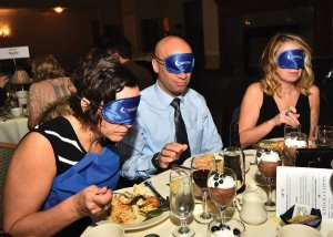 Guests dined with blindfolds to help them understand some of the challenges of vision loss.