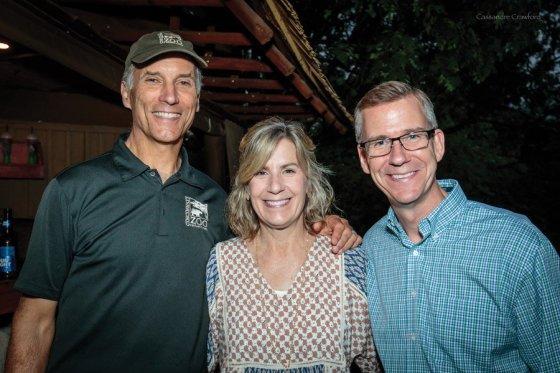 Thane Maynard, zoo director; Dawn Hock, Tulip Event committee member; and Chris Hock, zoo board member