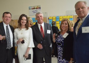 Jenny and Bob Kissell, with the group from KDM P.O.P. Solutions Group, a school corporate partner