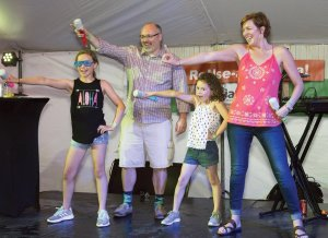 Board member Greg Hammond and wife Rebecca, performing with their children in the Lip Sync Battle