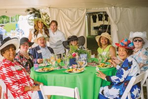 (Seated) sponsor Carole Rigaud, Amy Mersch, Lee Robinson, Britt Langman, Tonie Britton, Martha Heldkamp and Lois Conyers; (standing) Simone Rigaud Bonaguidi and Chef Renee Schuler of Eat Well