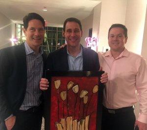 "Jim Huenninger and Shane Qualls, high bidders on Karen's painting ""Tupelo Honey,"" with Kent Wellington (center)"