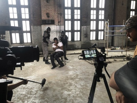 """Cincinnati Shakespeare Company actor Michael Morrow is filmed by Brave Berlin in the Gano Building. The sequences will be used in the projections that will become part of the visual environment of """"1984."""" (Photo: Snow Rowe/ Courtesy of Brave Berlin)"""
