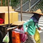 Taiwanese worker pulling cart