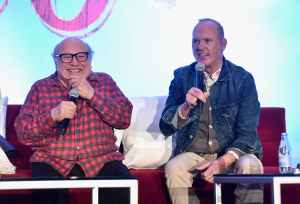 """BEVERLY HILLS, CA - MARCH 10: Actors Danny DeVito (L) and Michael Keaton speak onstage during the """"Dumbo"""" Global Press Conference at The Beverly Hilton Hotel on March 10, 2019 in Los Angeles, California. (Photo by Alberto E. Rodriguez/Getty Images for Disney) *** Local Caption *** Danny DeVito; Michael Keaton"""