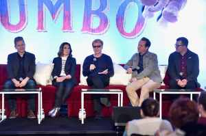 "BEVERLY HILLS, CA - MARCH 10: (L-R) Production Designer Rick Heinrichs, costume designer Colleen Atwood, composer Danny Elfman, screenwriter/producer Ehren Kruger and producer Justin Springer speak onstage during the ""Dumbo"" Global Press Conference at The Beverly Hilton Hotel on March 10, 2019 in Los Angeles, California. (Photo by Alberto E. Rodriguez/Getty Images for Disney) *** Local Caption *** Rick Heinrichs; Colleen Atwood; Danny Elfman; Ehren Kruger; Justin Springer"