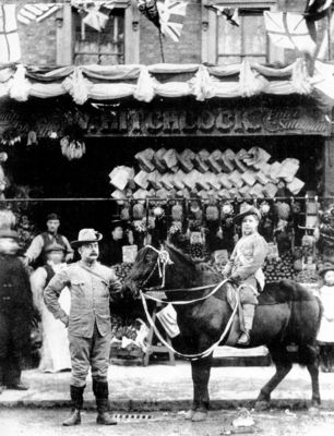 Hitchcock and his father in front of the family business