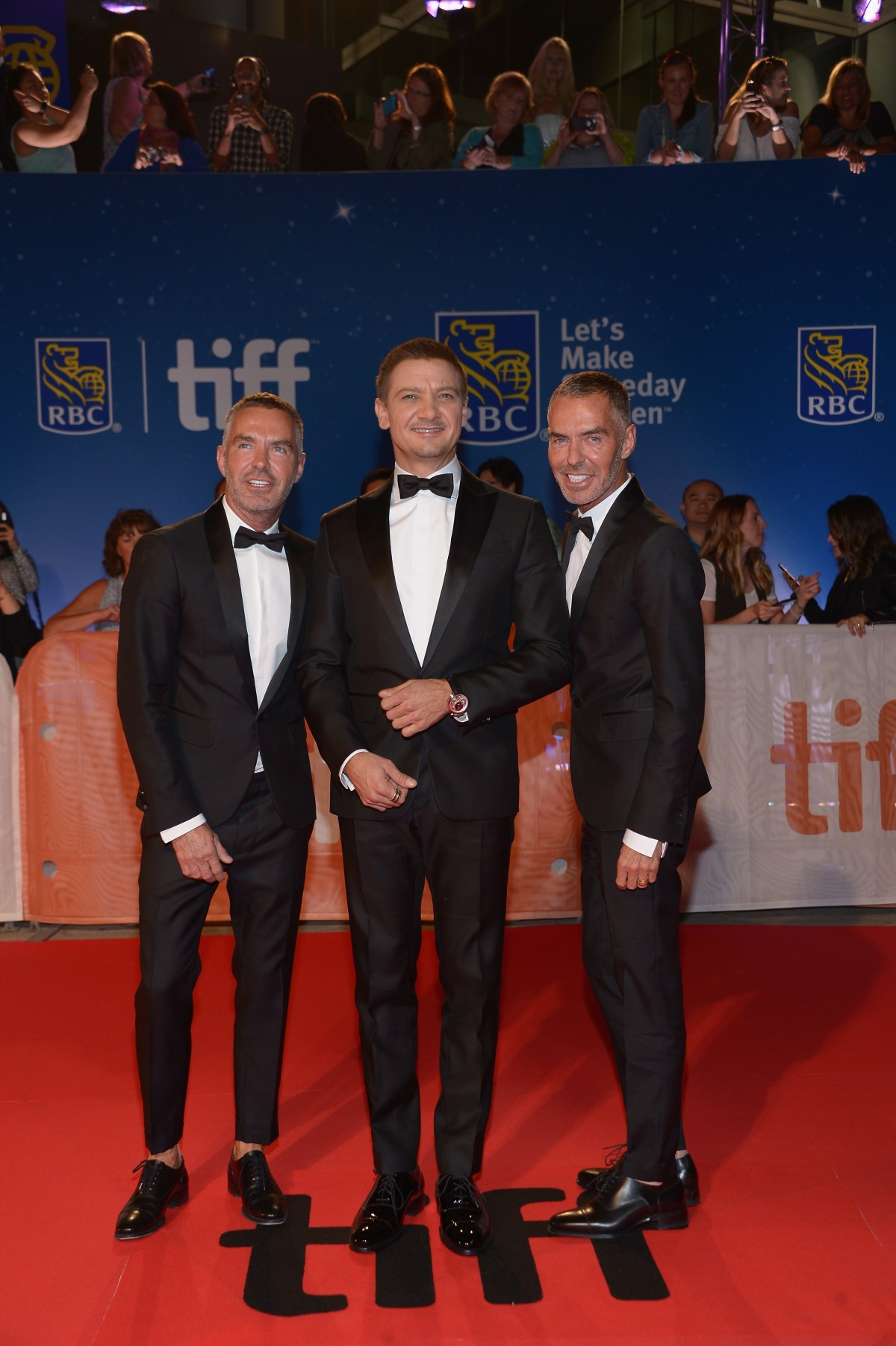 "TORONTO, ON - SEPTEMBER 12:  Actor Jeremy Renner (C) with Dean Caten and Dan Caten at the ""Arrival"" premiere during the 2016 Toronto International Film Festival at Roy Thomson Hall on September 12, 2016 in Toronto, Canada.  (Photo by GP Images/WireImage)"