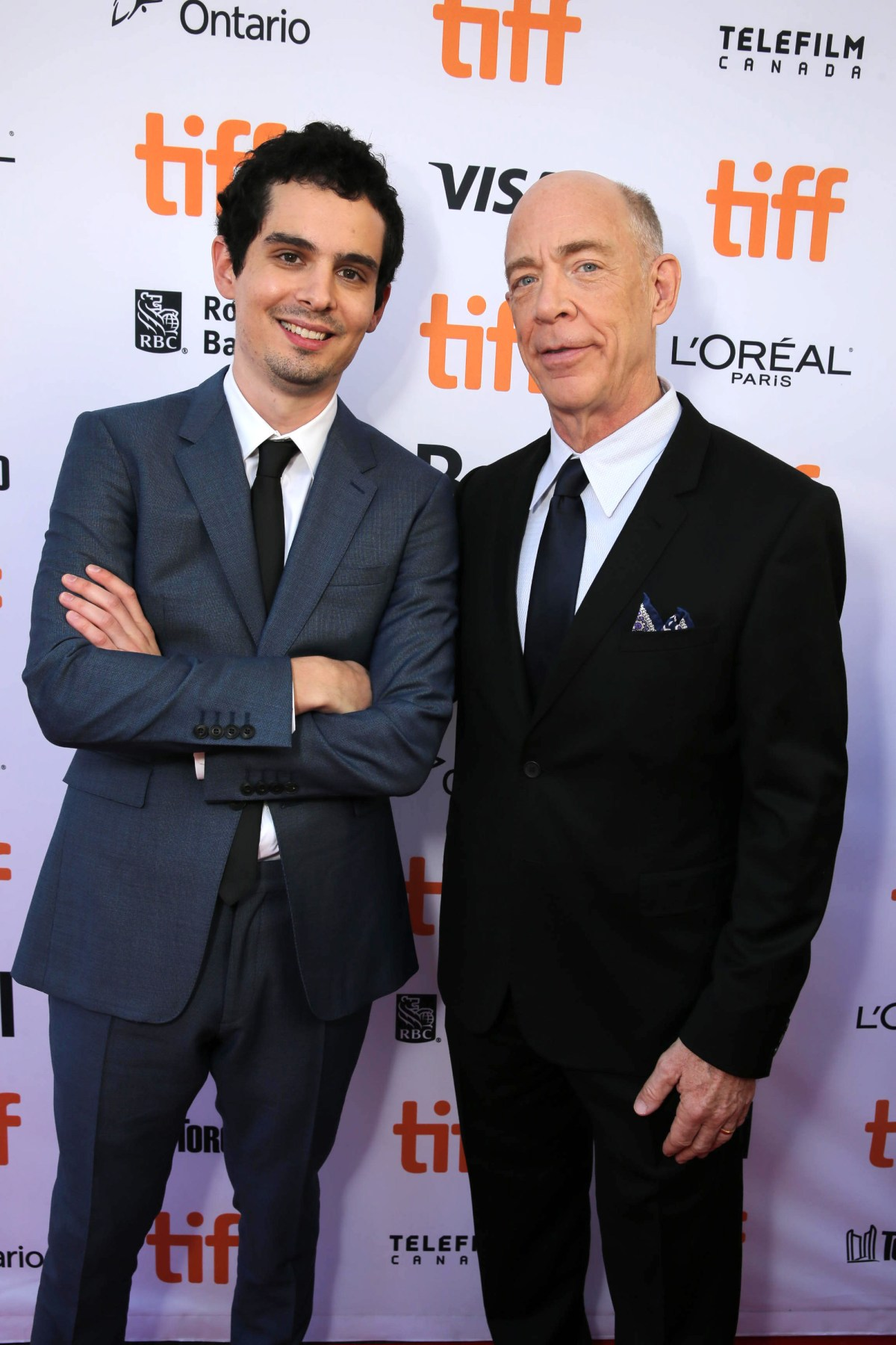 "Writer/Director Damien Chazelle and J.K. Simmons seen at Summit Entertainment's ""La La Land"" premiere at the 2016 Toronto International Film Festival on Monday, Sept. 12, 2016, in Toronto. (Photo by Eric Charbonneau/Invision for LionsgateAP Images)"