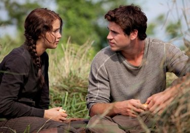 Jennifer Lawrence and Liam Hemsworth in a moment, in The Hunger Games