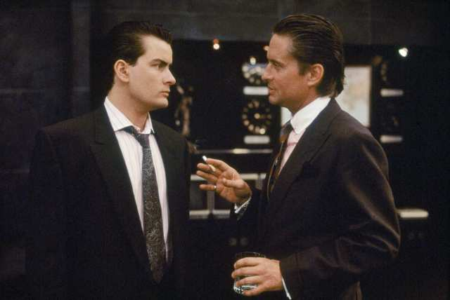 "FILE - In this 1987 file film publicity image originally released by 20th Century Fox, Charlie Sheen, left, and Michael Douglas are shown in a scene from ""Wall Street.""  (AP Photo/20th Century Fox, File) NO SALES"
