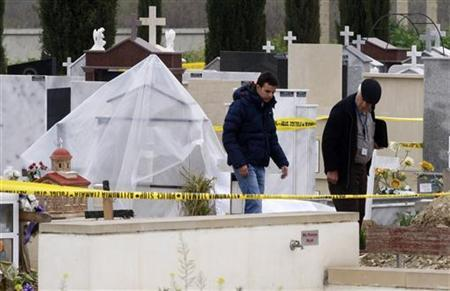A forensics team cordons off a grave where the body of former Cypriot President Tassos Papadopoulos was located in Nicosia