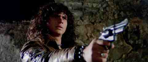 Escape-from-the-Bronx-movie-film-Italian-sci-fi-action-1983-review-reviews-Mark-Gregory-handgun