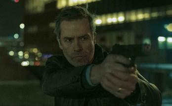 Zone-414-movie-film-sci-fi-humanoid-robots-2021-Guy-Pearce-handgun