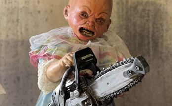 baby-oopsie-demonic-toys-movie-film-full-moon-chainsaw