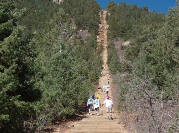 Hikers scale the Manitou Incline.