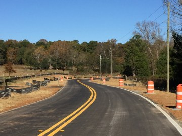 Photo of dirt road paving project