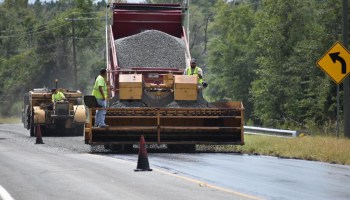 Photo of GDOT work crew resurfacing a roadway