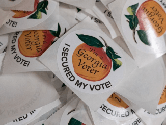 Photo of Georgia voter stickers (AJC photo / Ben Gray)