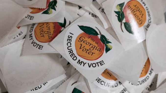 Photo of Georgia voter stickers (AJC photo / Ben Gray)