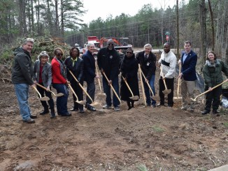 Photo of elected officials and community members breaking ground on the Panola Mountain greenway trail (Henry County photo)
