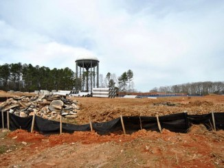 Photo of construction at the Fairview PAC with a water tower in the background (Henry Herald photo / Heather Middleton)