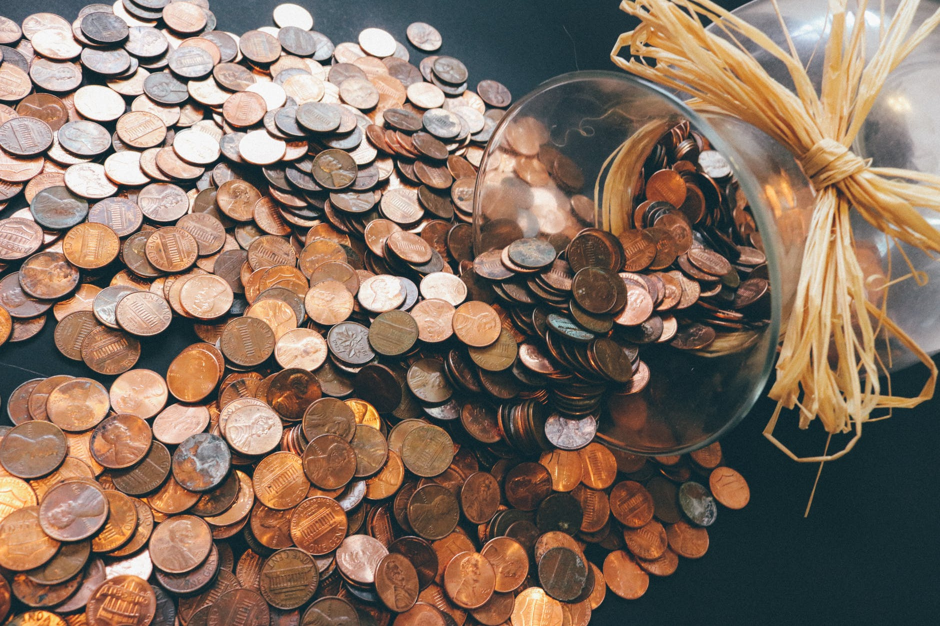 Photo of pennies spilled across a table (WordPress media photo)