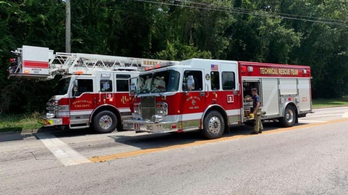 Photo of ladder truck and heavy rescue (Henry County Fire Dept photo)