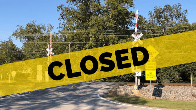 """Photo of Bowden Street railroad crossing with the word """"Closed"""" overlay (staff photo)"""