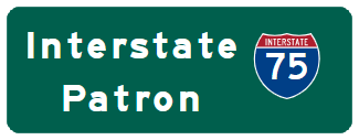 "Green Road Sign with blue and red I-75 sign and white text ""Interstate Patron"""
