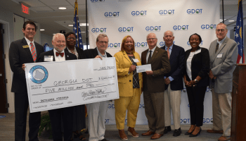 Photo of Henry County elected officials and staff presenting Georgia DOT with $5 million dollars for Bethlehem Road interchange (Henry County photo)