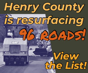 """Text """"Henry County is resurfacing 96 roads! View the list!"""" with photo of asphalt road crew. (Special photo)"""