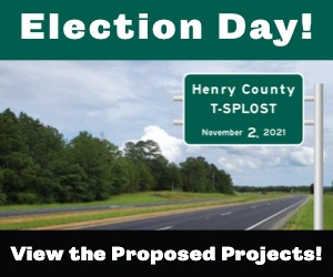 """Photo of T-SPLOST road sign with text """"Election Day! View the proposed projects!"""" (special photo)"""