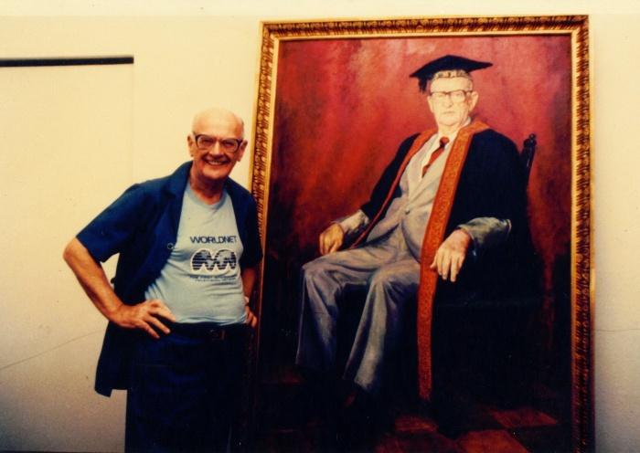 Sir Arthur Clarke with his Chancellor portrait by H R Premaratne, circa 1990
