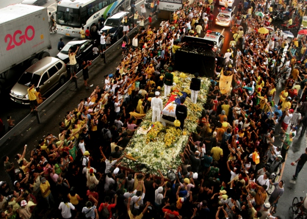 The remains of former Philippine president Corazon Aquino passes through the historical EDSA road with some 300,000 supporters waving to pay their last respect. The road is remembered in 1986 as then anonymous Cory and some 2 million people rallied out the streets to fight a 20-year government dictatorship through peaceful people power revolution. Photo by Arwin Doloricon/ Voyage Film