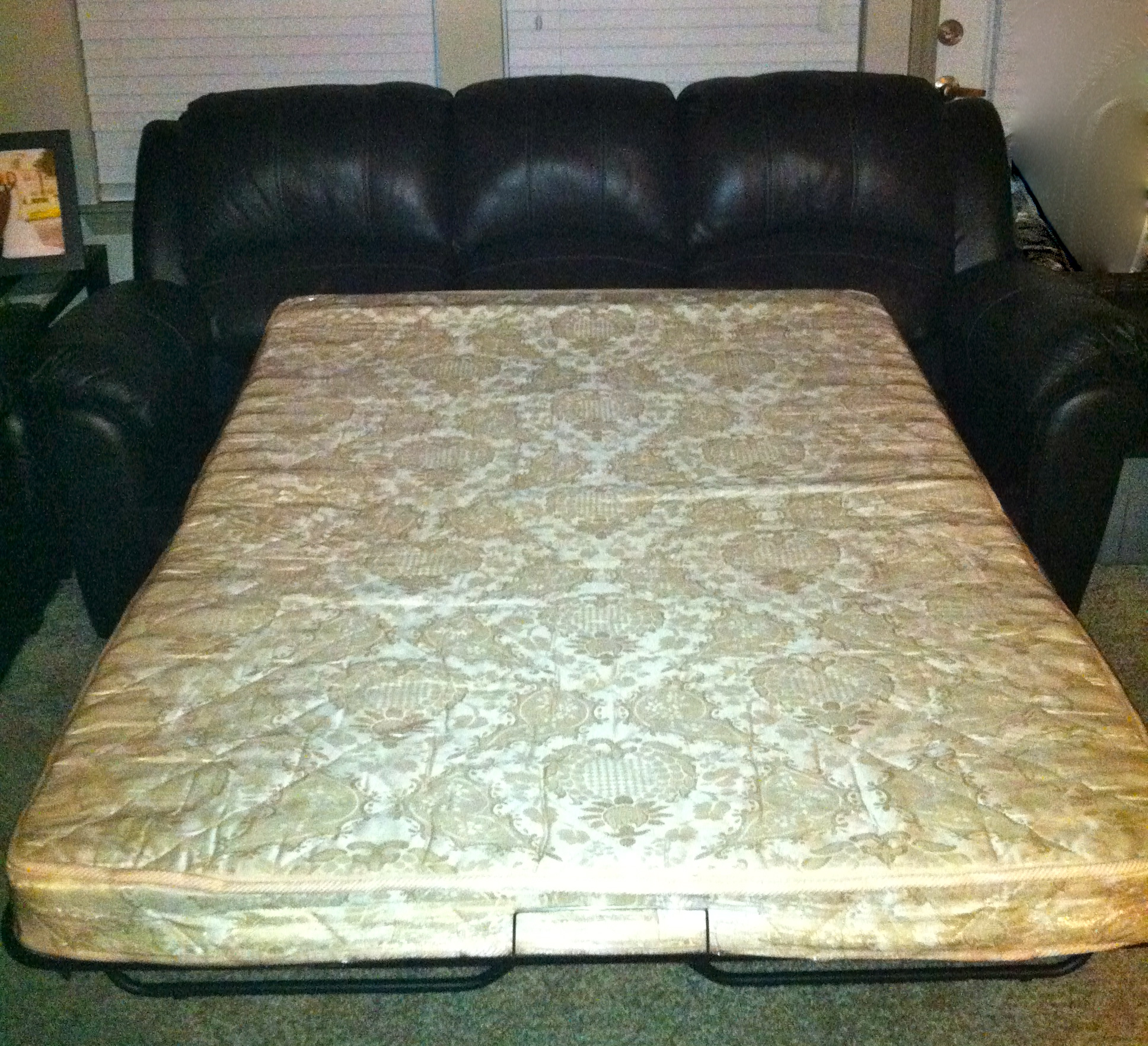Black Leather Couch with Pull Out Bed  650  STUFF FOR SALE
