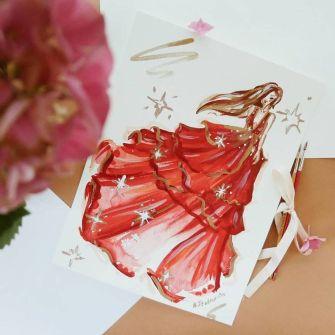 Anna crée de belles robes à l'aquarelle.
