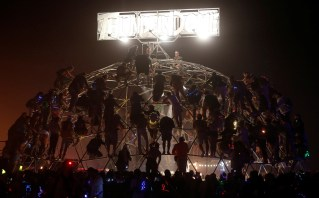 Participants climb atop Death Guild's Thunderdome to watch the fights below as approximately 70,000 people from all over the world gathered for the annual Burning Man arts and music festival in the Black Rock Desert of Nevada