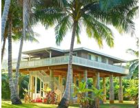 Une maison au bord du ruisseau à Moloaa Beach à Hawaii