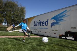 child kicking ball