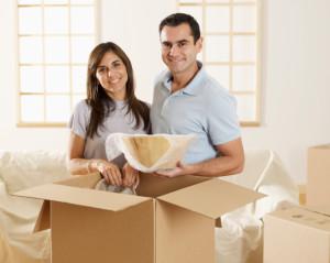 couple unpacking box