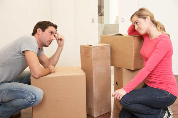 couple leaning on boxes