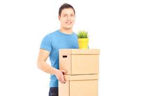 man holding boxes and plant