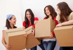 women moving boxes