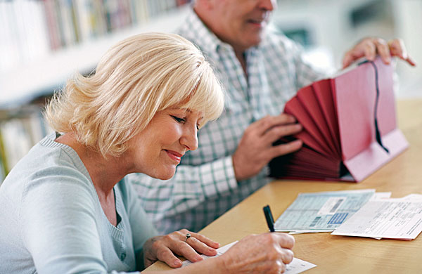 woman completing financial paperwork