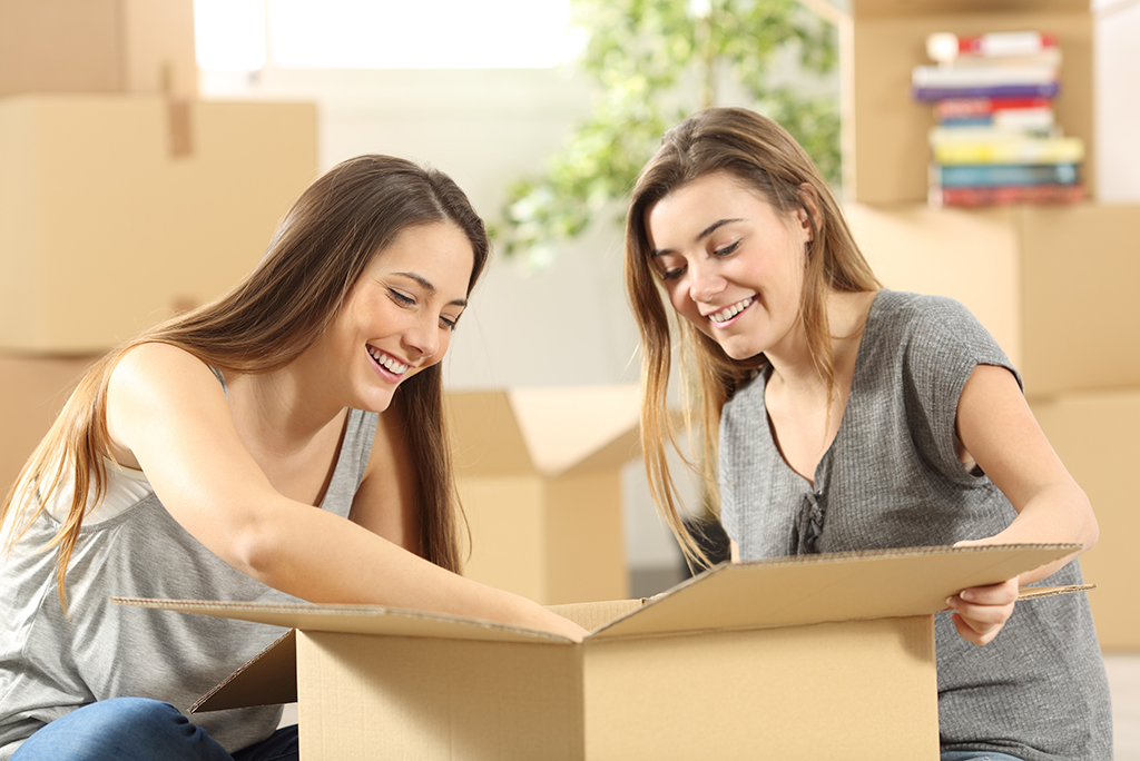 college students with boxes